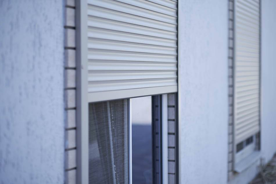 Window with half-closed roller shutter, closeup