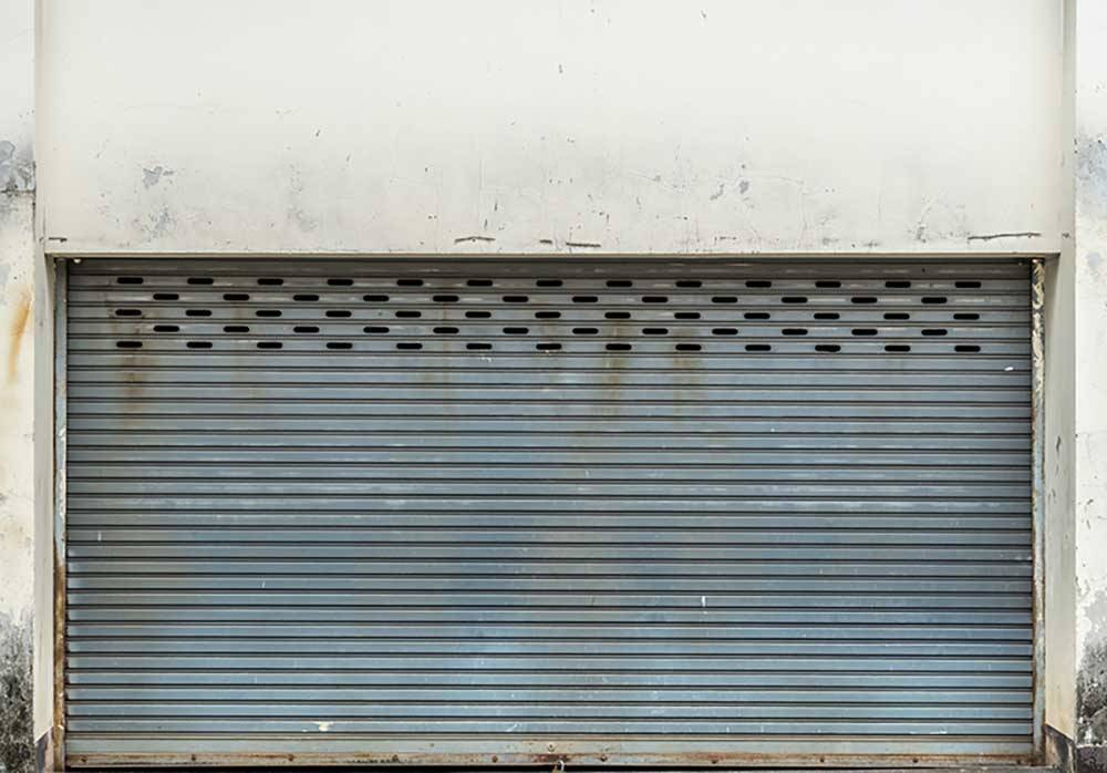 Old gray roller shutter door